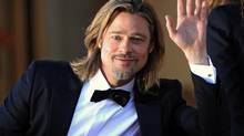 "Cast member Brad Pitt arrives on the red carpet ahead of the screening of the film ""Killing Them Softly"" at the 2012 Cannes Film Festival. (Yves Herman/Reuters)"