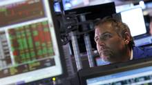 A trader works on the floor of the New York Stock Exchange, Friday, Aug. 31, 2012, in New York. (Jason DeCrow/AP)