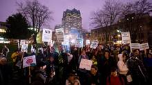 Protesters gathered in downtown Vancouver on Jan. 14 for a rally and march to a hotel that was hosting public hearings on Enbridge's Northern Gateway pipeline project. (Darryl Dyck/The Canadian Press)
