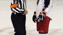 Referee Stephen Walkom talks with Rick Nash of the Columbus Blue Jackets in this 2011 file photo (Associated Press)