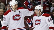 Montreal Canadiens right wing Andrei Kostitsyn (46) is congratulated by teammate Hal Gill (75) after scoring a goal in the first period of an NHL hockey game against the Anaheim Ducks in Anaheim, Calif., on Wednesday, Nov. 30, 2011. (AP Photo/Christine Cotter) (Christine Cotter/AP)