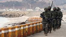 South Korean marines patrol on Yeonpyeong island near the western maritime border between the two Koreas, 11 km (7 miles) from the North, about 115 km (71 miles) northwest of Seoul March 12, 2013. North Korea fired dozens of artillery shells at the border island on November 23, 2010, killing two civilians and South Korean soldiers in the heaviest attack on its neighbour since the Korean War ended in 1953. The White House on Monday expressed concern at what it called North Korea's latest provocations aimed at raising tensions and instability in Northeast Asia. (YONHAP/REUTERS)