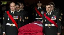 Members of The Royal Canadian Regiment carry the casket of Warrant Officer Michael Robert McNeil at his funeral in Truro, N.S., in December, 2013. WO McNeil killed himself the month before. (Andrew Vaughan/THE CANADIAN PRESS)