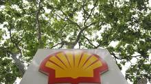 A logo is seen under a canopy of trees at a Shell petrol station in central London July 29, 2010. (TOBY MELVILLE/REUTERS)