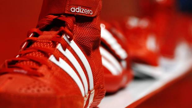 """A pair of Adidas """"Adizero"""" sport shoes on display at the company's innovation laboratory in Herzogenaurach, May 7, 2012. (MICHAEL DALDER/REUTERS)"""
