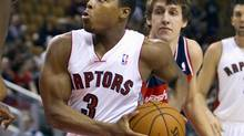 Toronto Raptors' Kyle Lowry (L) drives to the basket past Washington Wizards' Jan Vesely in the first half of their pre-season NBA game in Toronto October 17, 2012. (FRED THORNHILL/REUTERS)