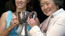 Former governor general Adrienne Clarkson presents then Team Canada captain Cassie Campbell with the Clarkson Cup during a 2006 ceremony in Toronto (ADRIAN WYLD/The Canadian Press)