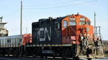 The government and CN said the deal would ensure continued freight service for 15 years on the rail line's northern and southern sections. (Graham Hughes/THE CANADIAN PRESS)