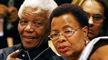 Former South African president Nelson Mandela and his wife Graca Machel sit in the gallery at the opening of Parliament in Cape Town on Feb. 11, 2010. (POOL/POOL/REUTERS)
