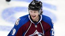 Colorado Avalanche centre Nathan MacKinnon reacts to his assist against the Minnesota Wild in the second period during Game 2 of the first round of the 2014 Stanley Cup Playoffs at the Pepsi Center. (USA TODAY Sports)