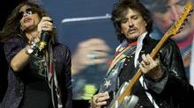 Steven Tyler, left, and Joe Perry of Aerosmith perform in Vancouver. (Jeff Vinnick/Jeff Vinnick for the Globe and Mail)