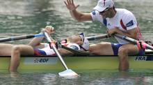 Cedric Berrest and Julien Bahain of France react after the Men's Double Sculls final at the World Rowing Championships in Bled September 2, 2011. (Srdjan Zivulovic/REUTERS)