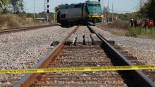 Police tape marks off the scene where a Via Rail train collided with an Ottawa bus in the southern suburb of Barrhaven on Sept. 18, 2013. (DAVE CHAN FOR THE GLOBE AND MAIL)
