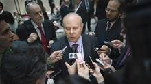 Brazilian Finance Minister Guido Mantega speaks to reporters after the International Monetary and Financial Committee meeting in Washington on Saturday. (Jonathan Ernst/Reuters)