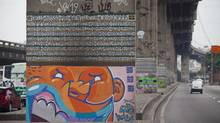 The poetic graffiti murals of Jose Datrino, known as Gentileza, are threatened by the demolition of the Perimetral, a highway that runs through downtown Rio de Janeiro, Brazil. (Lianne Milton)