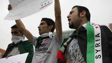 Syrian Kurds wearing Syrian opposition flags chant slogans and carry placards during a sit-in in front of the United Nations headquarters in Beirut, in solidarity with anti-government protesters in Syria, April 29, 2012. (Cynthia Karam/Reuters/Cynthia Karam/Reuters)