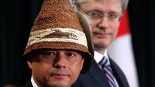 Assembly of First Nations Chief Shawn Atleo (L) and Canada's Prime Minister Stephen Harper take part in the opening ceremony at the Crown-First Nations Gathering in Ottawa January 24, 2012. (Chris Wattie/Reuters)