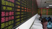Investors look at computer screens showing stock information on the first trading day after the week-long Lunar New Year holiday at a brokerage house in Shanghai, China, February 15, 2016. (Aly Song/REUTERS)