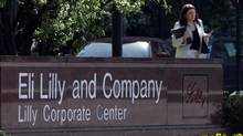 ** FILE ** A women leaves the Eli Lilly and Company campus in an Indianapolis file photo from April 18, 2006. (MICHAEL CONROY/AP)