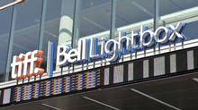 An outdoor sign on the front of the TIFF Bell Lightbox in Toronto.