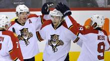 Florida Panthers' Kris Versteeg (C) celebrates his goal against the Winnipeg Jets with teammates Brian Campbell (L) and Stephen Weiss during the first period of their NHL game in Winnipeg, November 10, 2011. (FRED GREENSLADE)