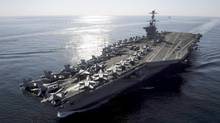 The aircraft carrier USS John C. Stennis transits the Straits of Hormuz in this U.S. Navy handout photo dated November 12, 2011. (HANDOUT/REUTERS)