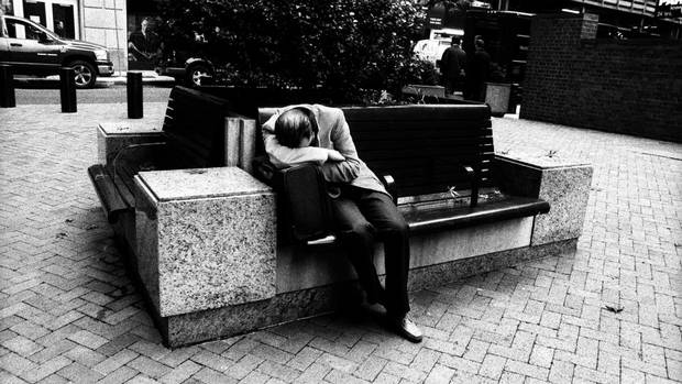 A worker rests his head on his accountant bag on a bench in the financial district in New York. When one of Wall Street's largest investment banks, Lehman Brothers Holdings Inc., went under, the biggest global financial crisis since the Great Depression was on. (Sami Siva for The Globe and Mail)