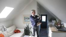 Colin Gillies, 62, on the top floor of his Toronto home which he rents out. 'It's been a lifesaver. I wasn't going to perish … Airbnb gave me the opportunity to have a little fun in my life and meet people,' he says. (Chris Young for The Globe and Mail)