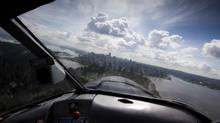 Greg McDougall CEO of Harbour Air flies his float plane in for a landing in Vancouver's harbour front May 17, 2011. (John Lehmann/The Globe and Mail/John Lehmann/The Globe and Mail)