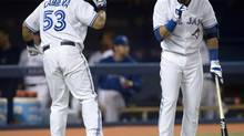 Toronto Blue Jays' Melky Cabrera is congratulated by teammate Jose Bautista after his solo homer during fourth inning AL action against the Texas Rangers in Toronto on Friday June 7, 2013. (Frank Gunn/THE CANADIAN PRESS)