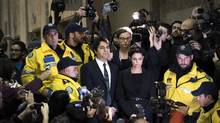 Jian Ghomeshi makes his way through a mob of media with his lawyer Marie Henein at a Toronto court in November, 2014. (Darren Calabrese/THE CANADIAN PRESS)