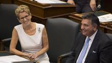 Ontario Premier Kathleen Wynne and Charles Sousa, smile following the speech from the throne, opening the second session of the 41st Parliament of Ontario, in Toronto on Monday Sept. 12, 2016. THE CANADIAN PRESS/Peter Power (Peter Power/THE CANADIAN PRESS)