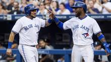 The Blue Jays' Melky Cabrera, left, and Jose Reyes celebrate after both scoring off an Adam Lind double against the Chicago White Sox in Toronto on Thursday. (Chris Young/THE CANADIAN PRESS)
