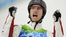 Canada's Warren Shouldice celebrates after his second jump during the men's freestyle skiing aerials qualification round at the Vancouver 2010 Winter Olympics, February 22, 2010. (Dylan Martinez/REUTERS)