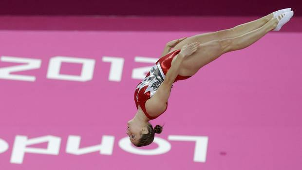 <p> Canada's <strong>Rosannagh</strong> <strong>Maclennan</strong> performs during the women's trampoline qualification at the 2012 Summer Olympics, Friday, in London.</p>