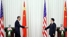 U.S. President Barack Obama crossed the dais to shake hands with Chinese President Hu Jintao after a joint press conference at the Great Hall of People on Tuesday. (Feng Li/2009 Getty Images)