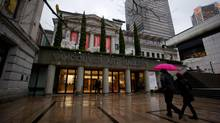 A couple walks into the Vancouver Art Gallery, the site of Family Fuse Weekend, in Vancouver, B.C., (DARRYL DYCK For The Globe and Mail)
