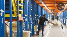 Workers at the Best Buy distribution centre are seen at the facility located in Brampton, ON. (Kevin Van Paassen/The Globe and Mail)