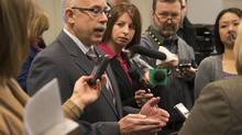 Nova Scotia Justice Minister Ross Landry fields questions at a news conference in Halifax on Feb. 6, 2013. (ANDREW VAUGHAN/THE CANADIAN PRESS)