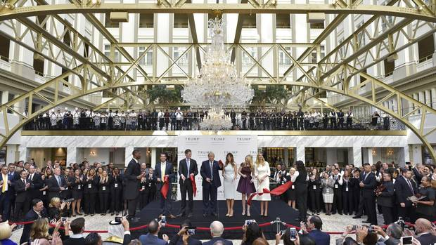 From left: Donald Trump Jr, Eric Trump, Republican presidential nominee Donald Trump, Melania Trump, Tiffany Trump, and Ivanka Trump take part in a ribbon cutting ceremony during the grand opening of the Trump International Hotel in Washington, DC on October 26, 2016