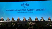 Trade ministers and officials from the 12 Trans-Pacific Partnership (TPP) member nations at the signing ceremony in Auckland, New Zealand. (REUTERS TV/REUTERS)