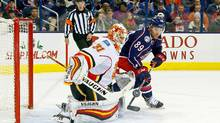 On his way to a 2-0 shutout against the Blue Jackets on Nov. 23, Calgary goaltender Chad Johnson blocks a shot by Sam Gagner in Columbus, Ohio. (Kirk Irwin/Getty Images)