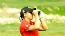 Golfer using a distance measuring device (Courtesy Golf Canada)