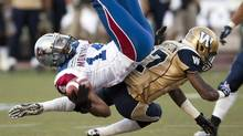 Montreal Alouettes receiver Brandon London, left, is tackled by Winnipeg Blue Bombers Demond Washington during first quarter Canadian Football League pre-season action Thursday, June 14, 2012 in Montreal. (Ryan Remiorz/THE CANADIAN PRESS)