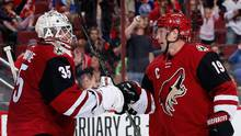 Goaltender Louis Domingue #35 of the Arizona Coyotes is congratulated by Shane Doan #19 after defeating the Calgary Flames 4-1 in the NHL game at Gila River Arena on February 12, 2016 in Glendale, Arizona. (Christian Petersen/Getty Images)