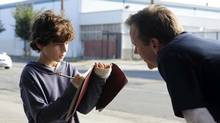 "David Mazouz as Jake Bohm (left) and Kiefer Sutherland as Martin Bohm in a scene from an episode of ""Touch."" (Richard Foreman/AP)"