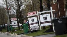 Houses with 'sold over asking' signs in Mississauga, west of Toronto. (Mark Blinch/The Globe and Mail)