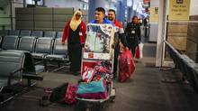 Syrian refugees arrive at the Pearson Toronto International Airport in Mississauga. (Mark Blinch/Reuters)