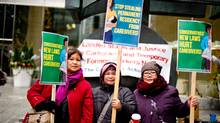 Caregivers rally for permanent residency status at the Federal Ministers Headquarters in Toronto. (Caregivers Action Centre)