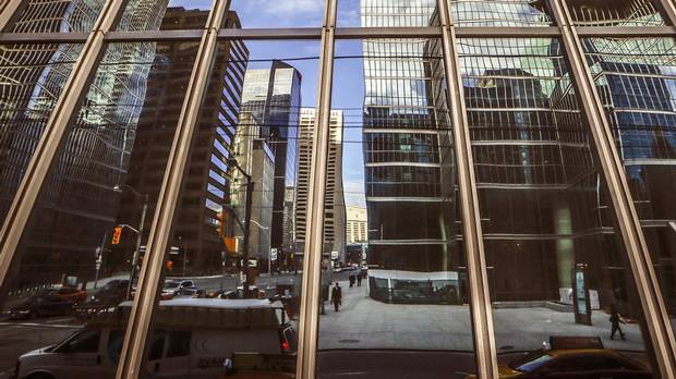 Buildings reflected in glass in Toronto's Financial District, on Thursday January 22, 2015.